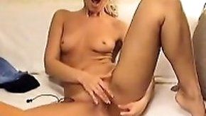 Attractive blonde stripteasing her vagina with dildo e